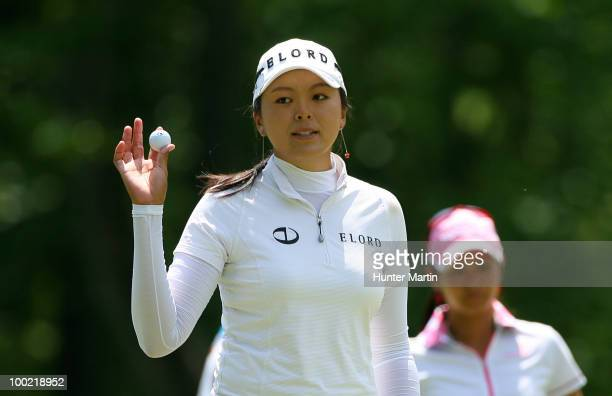 J Hur of South Korea waves to the crowd on the third hole during the second round of the Sybase Match Play Championship at Hamilton Farm Golf Club on...