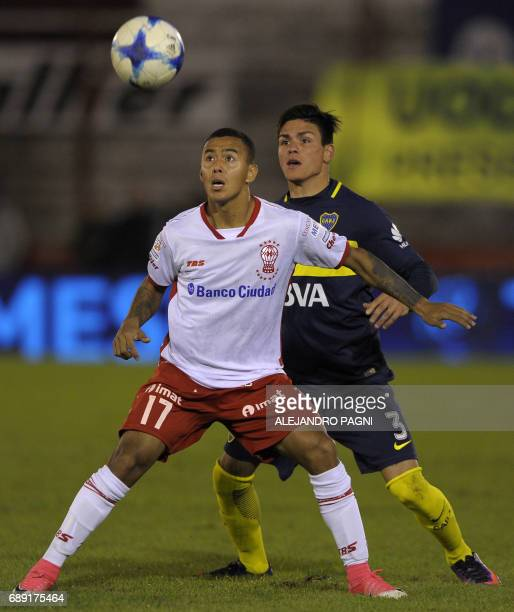 Huracan's midfielder Alejandro Gamarra vies for the ball with Boca Juniors' defender Jonathan Silva during their Argentina First Division football...