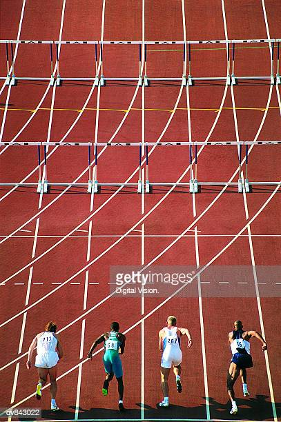hurdle race - men's track stock pictures, royalty-free photos & images