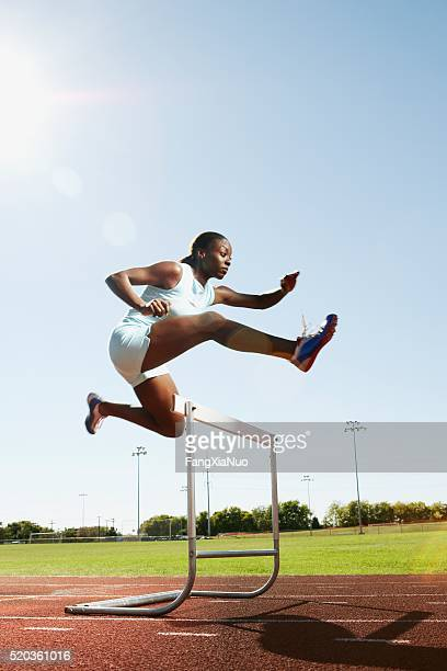 hurdler in air - hurdling stock photos and pictures