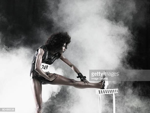 A hurdler stretching