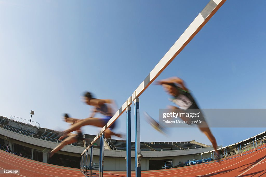 Hurdlers Hurdling Hurdles : Stock Photo