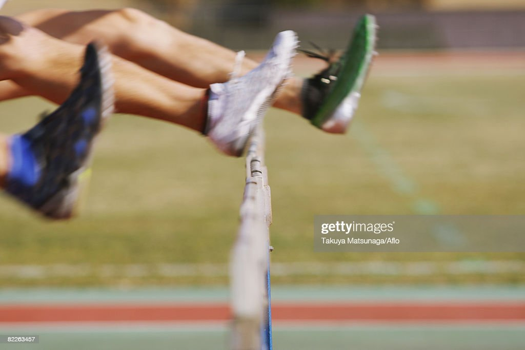 Hurdlers Hurdling Hurdles : Stock Photo