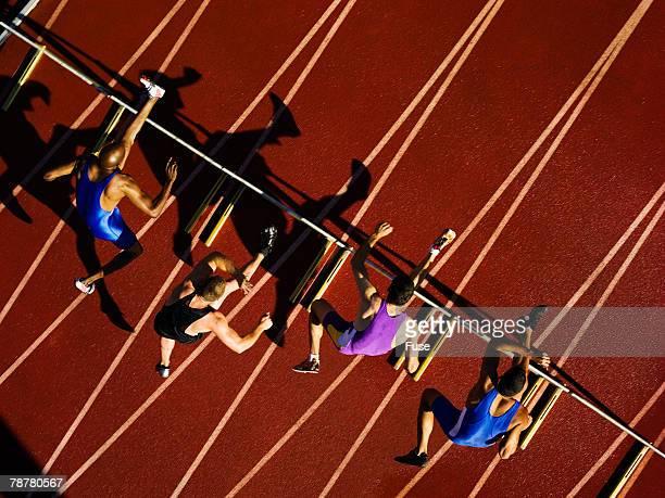 Hurdlers Jumping Hurdles