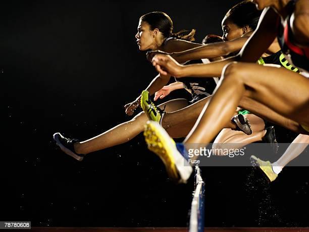 Hurdlers Jumping