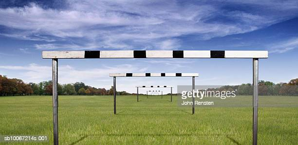 hurdles in field - hurdle stock pictures, royalty-free photos & images
