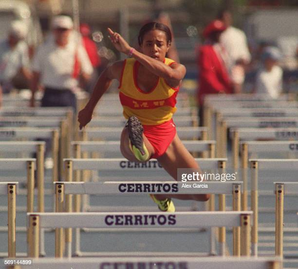 SP Hurdles new0601AAG––Ashley Bethel of Mission Viejo jumps through the hurdles on route to a second place finish at the CIF State Finals held at...