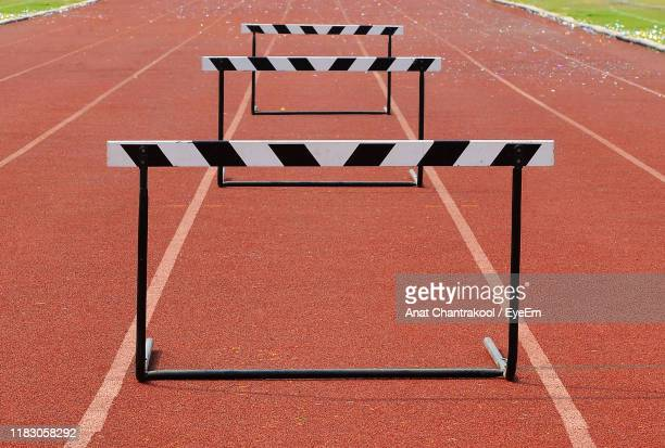 hurdles on running track - hurdle stock pictures, royalty-free photos & images