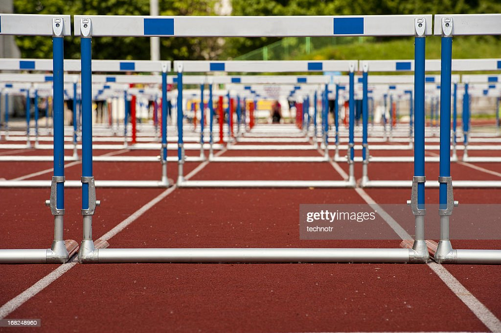 Hurdles ready for race : Stock Photo