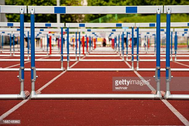 hurdles ready for race - hurdling stock photos and pictures