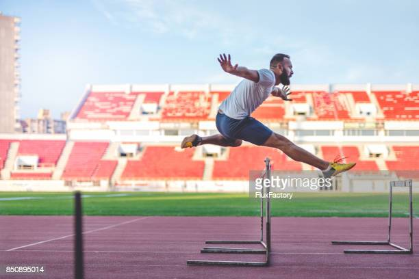 hurdling - hurdling stock photos and pictures