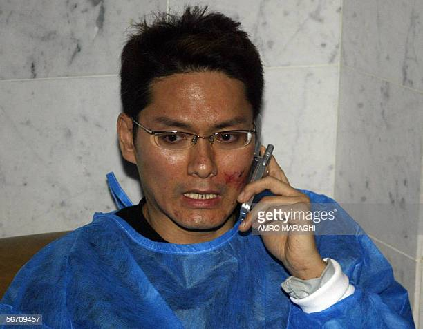 An injured tourist phones home in the Hurghada hospital 31 January 2006 after fourteen Hong Kong tourists were killed and 30 wounded when their bus...