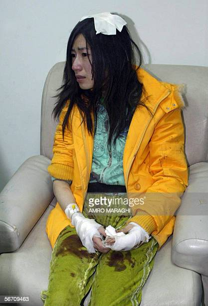 An injured tourist waits in the Hurghada hospital 31 January 2006 after fourteen Hong Kong tourists were killed and 30 wounded when their bus spun...