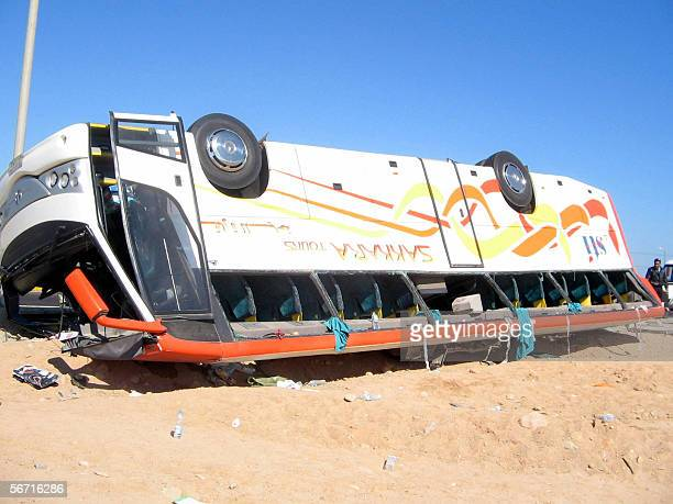 An overturned tourist bus lies in the desert in Hurghada 31 Janaury 2006 after the bus spun off the coastal road along the Red Sea killing fourteen...