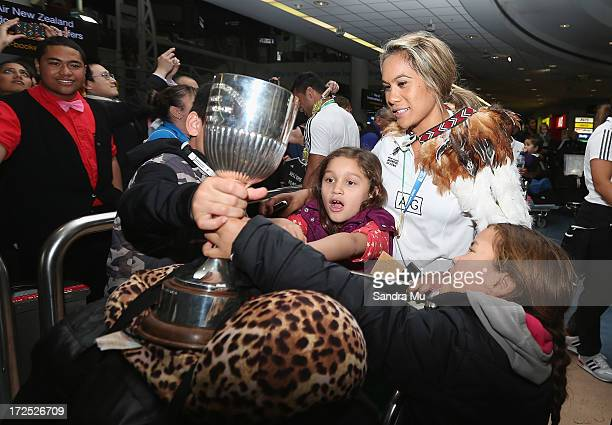 Huriana Manuel, captain of the New Zealand Woman's Sevens team is greeted by her nieces as she arrives at Auckland International Airport on July 3,...