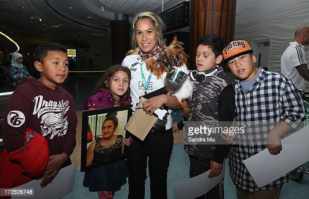 Huriana Manuel captain of the New Zealand Woman's Sevens team is greeted by her nieces and nephews as she arrives at Auckland International Airport...