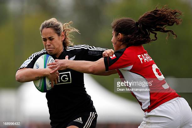 Huriana Manuel of New Zealand breaks through past Bianca Farella of Canada during the IRB Women's Sevens World Series Final match between New Zealand...