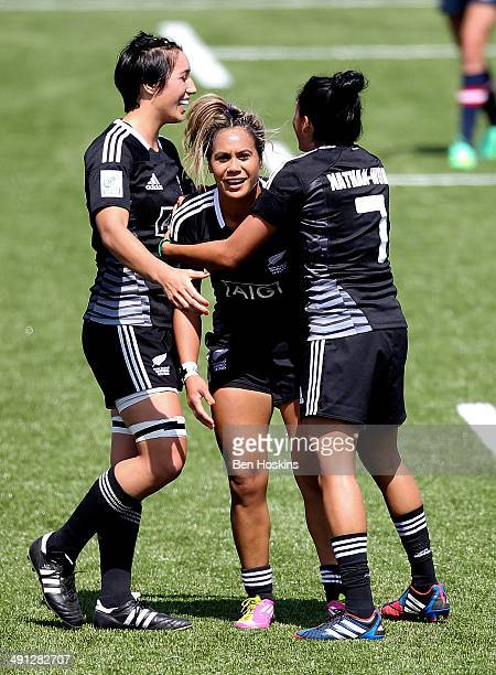 Huriana Manuel of New Zealand is congratulated by team mates after scoring a try during the IRB Womens Sevens match between New Zealand and The USA...