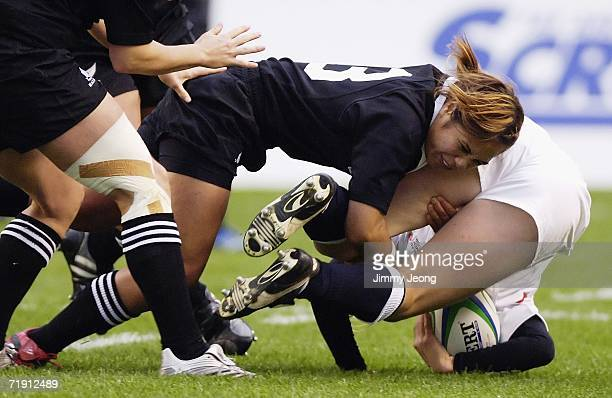 Huriana Manuel of New Zealand makes a tackle on Charlotte Barras of England in the gold medal match between New Zealand and England during day six of...