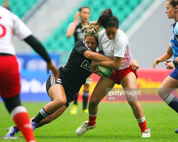 Huriana Manuel of New Zealand Women's Sevens team makes a break in the match against Tunisia during the third round of the IRB Women's Sevens World...