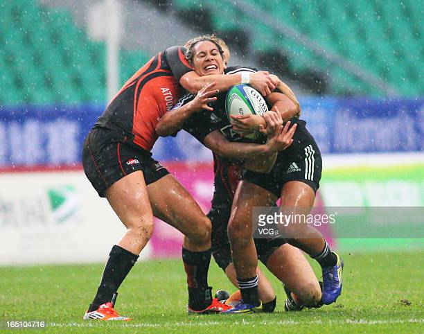 Huriana Manuel of New Zealand Women's Sevens team makes a break in the match against Netherlands during the third round of the IRB Women's Sevens...