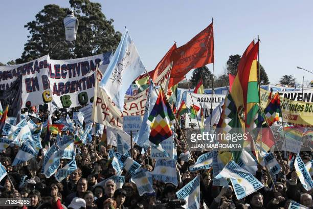 Argentinian people and Bolivian immigrants wave flags during a rally before the signature of a bilateral agreement about gas price between Bolivia...