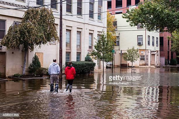 Hurrican Sandy: people walking on a flooded street