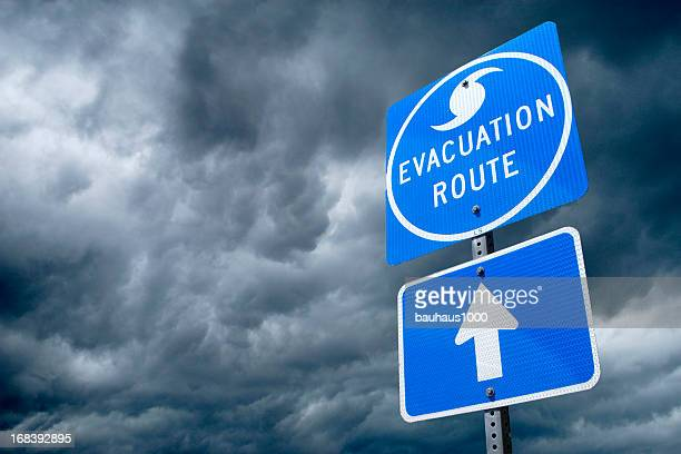 hurricane evacuation route road sign - thoroughfare stock photos and pictures