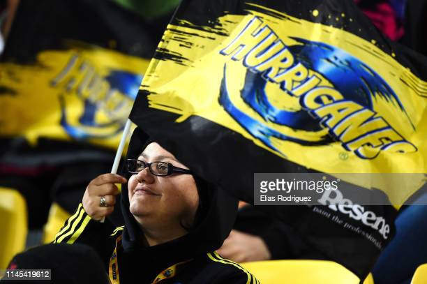 Hurricane fan celebrates a try being scored during the round 11 Super Rugby match between the Hurricanes and Chiefs at Westpac Stadium on April 27...