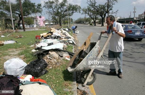Hurricane holdout Rodney Hoover dumps debris from his home September 12 2005 in New Orleans Louisiana Rescue efforts and clean up continue in the...