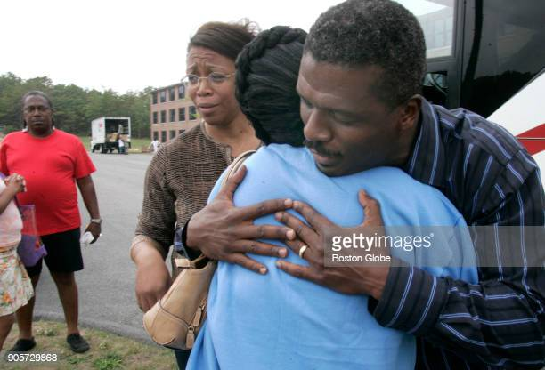 Hurricane Katrina evacuee Angela George of New Orleans is consoled by Reverend Jeffrey Brown inside the housing area where the evacuees are living at...
