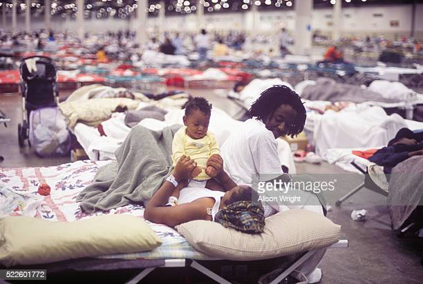 hurricane katrina evacuees in the houston astrodome - hurricane katrina stock pictures, royalty-free photos & images