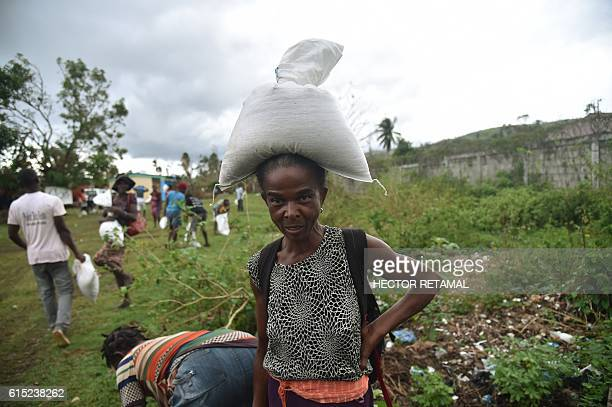 Hurricane Matthew Haitian victims receive food from the UN's World Food Programme in the commune of Maniche, in Les Cayes, in the south west of...