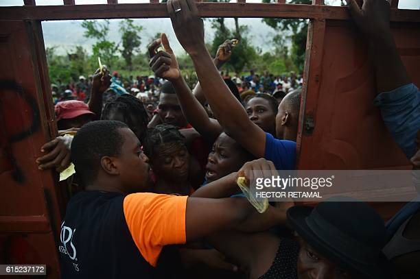 Hurricane Matthew victims wait for the start of delivery of food from the UN's World Food Programme in the commune of Maniche, in Les Cayes, in the...