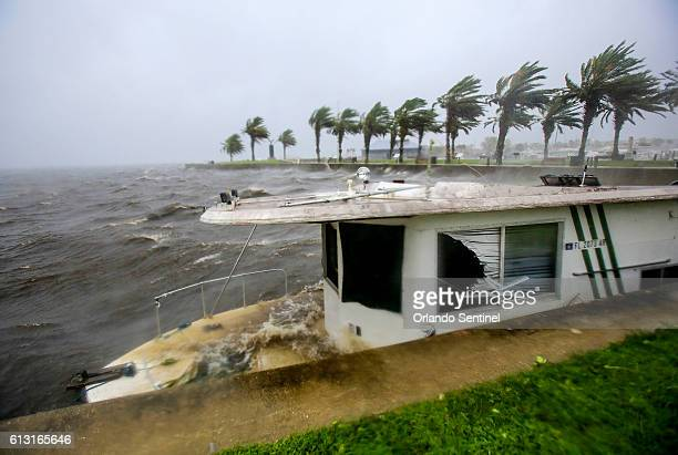 Hurricane Matthew winds washed up a boat as it bashes into the seawall at Lake Monroe in downtown Sanford on Friday October 7 2016