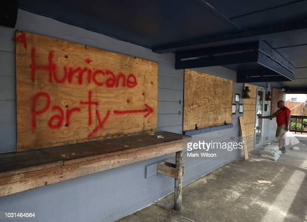 Hurricane Party is written on plywood covering the window of the Lager Heads Tavern as they prepare for the arrival of Hurricane Florence on...