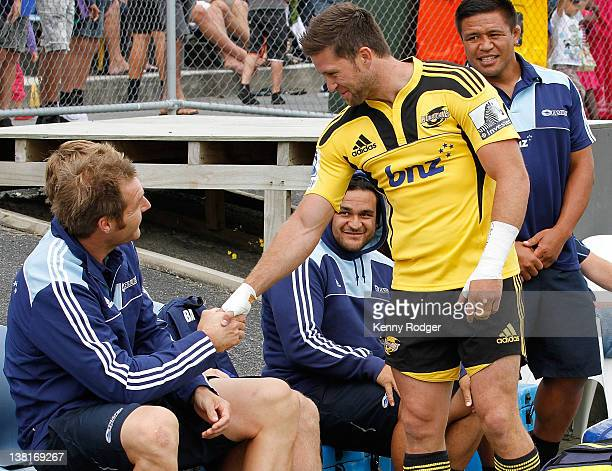 Hurricane player Cory Jane greets his fellow All Black and Blues opponent Ali Williams as Piri Weepu and Keven Mealamu look on prior to kickoff in...
