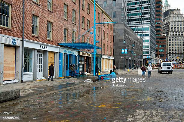 hurricane sandy aftermath, south street seaport district, new york city - boarded up stock photos and pictures