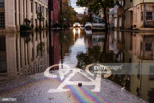 Hurricane Sandy: road sign submerged on a flooded street