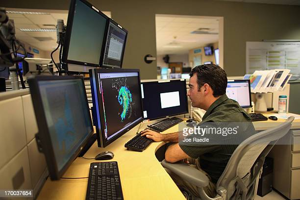 Hurricane Specialist John Cangialosi charts the path of Tropical Storm Andrea at the National Hurricane Center on June 6 2013 in Miami Florida Andrea...