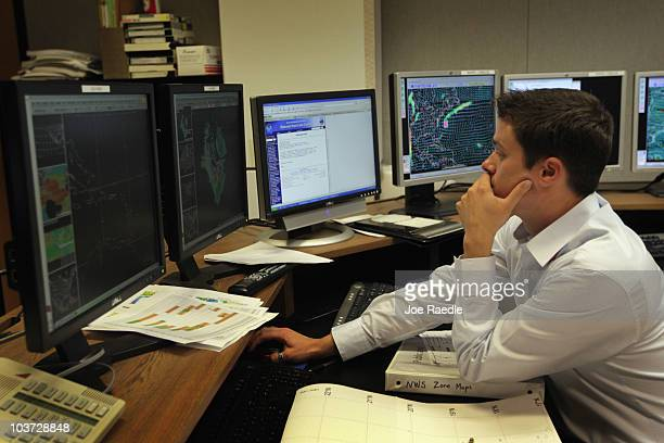 Hurricane Specialist Robbie Berg studies computer models as he tracks Hurricane Earl at the National Hurricane Center on August 30 2010 in Miami...
