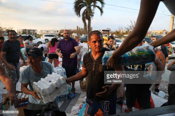 Hurricane victims accept relief items such as water food clothes and animal food that were gathered by Gorilla Restoration and Gil Sosa design...