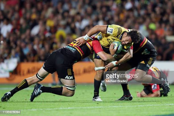 Hurricanes Ardie Savea is tackled during the round five Super Rugby match between the Chiefs and the Hurricanes at FMG Stadium on March 15 2019 in...