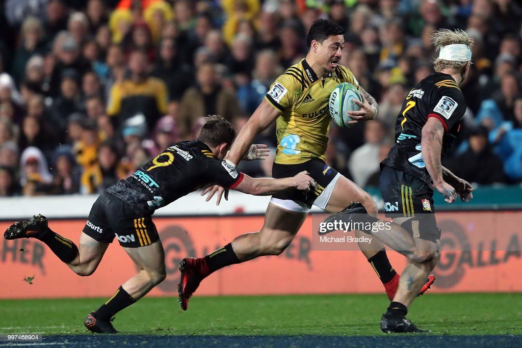 Hurricanes' Ben Lam evades the tackle from the Chiefs Brad Weber (L) during the round 19 Super Rugby match between the Chiefs and the Hurricanes at Waikato Stadium on July 13, 2018 in Hamilton, New Zealand.