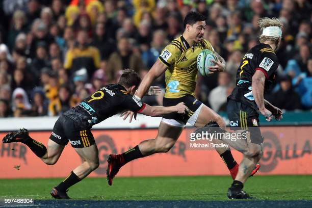 Hurricanes' Ben Lam evades the tackle from the Chiefs Brad Weber during the round 19 Super Rugby match between the Chiefs and the Hurricanes at...