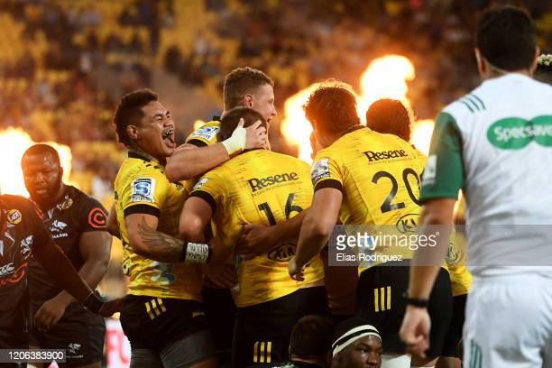 Hurricanes celebrate Danes Coles scoring a try during the round 3 Super Rugby match between the Hurricanes and the Sharks at Westpac Stadium on...