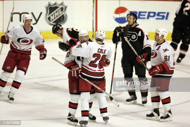 Hurricanes defenseman Oleg Tverdovsky is congratulated by teammate Erik Cole after scoring a third period game tying goal at the Wachovia Center in...