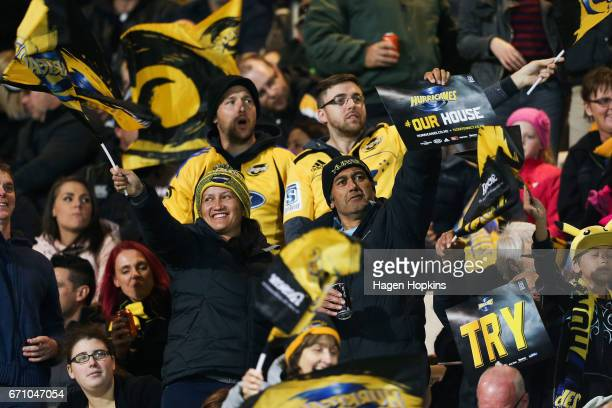 Hurricanes fans celebrate a try during the round nine Super Rugby match between the Hurricanes and the Brumbies at McLean Park on April 21 2017 in...
