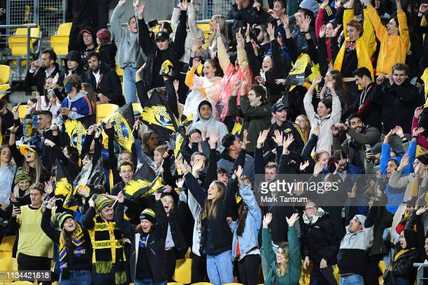 Hurricanes fans celebrate during the round 4 Super Rugby match between the Wellington Hurricanes and Otago Highlanders at Westpac Stadium on March 08...