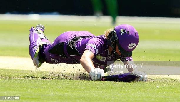 Hurricanes Georgia Redmayne dives to make her ground during the Women's Big Bash League during the Hobart Hurricanes and the Melbourne Stars at...